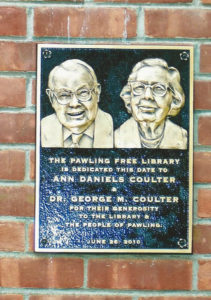 The plaque honoring Doctor Coulter and his mother, which is mounted on the front of the library building.
